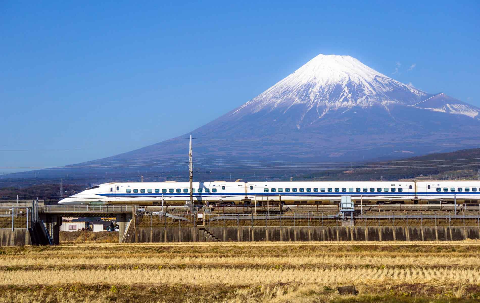 A Japanese bullet train passes Mount Fuji