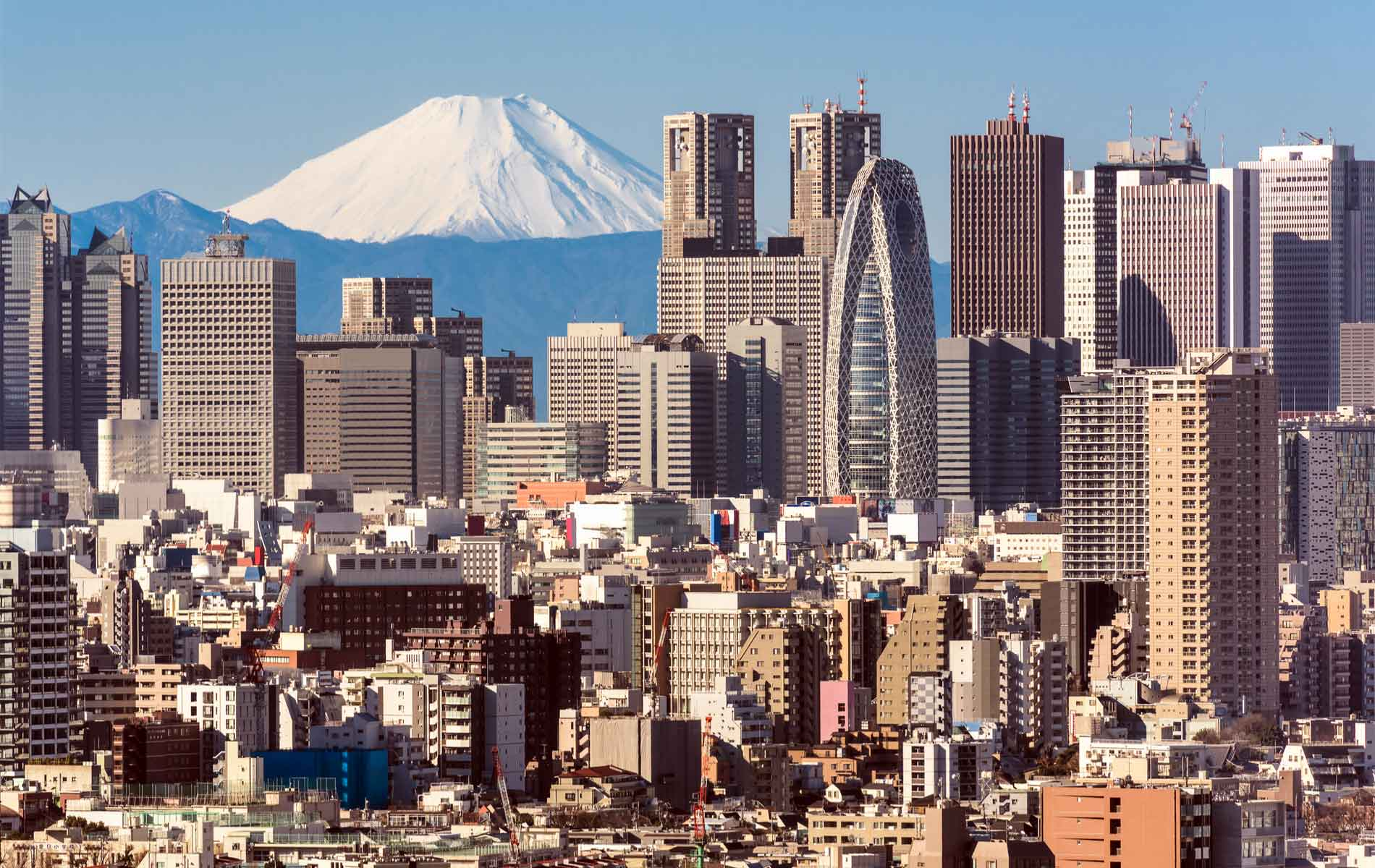 Mount Fuji sitting behind the skyscrapers of Tokyo