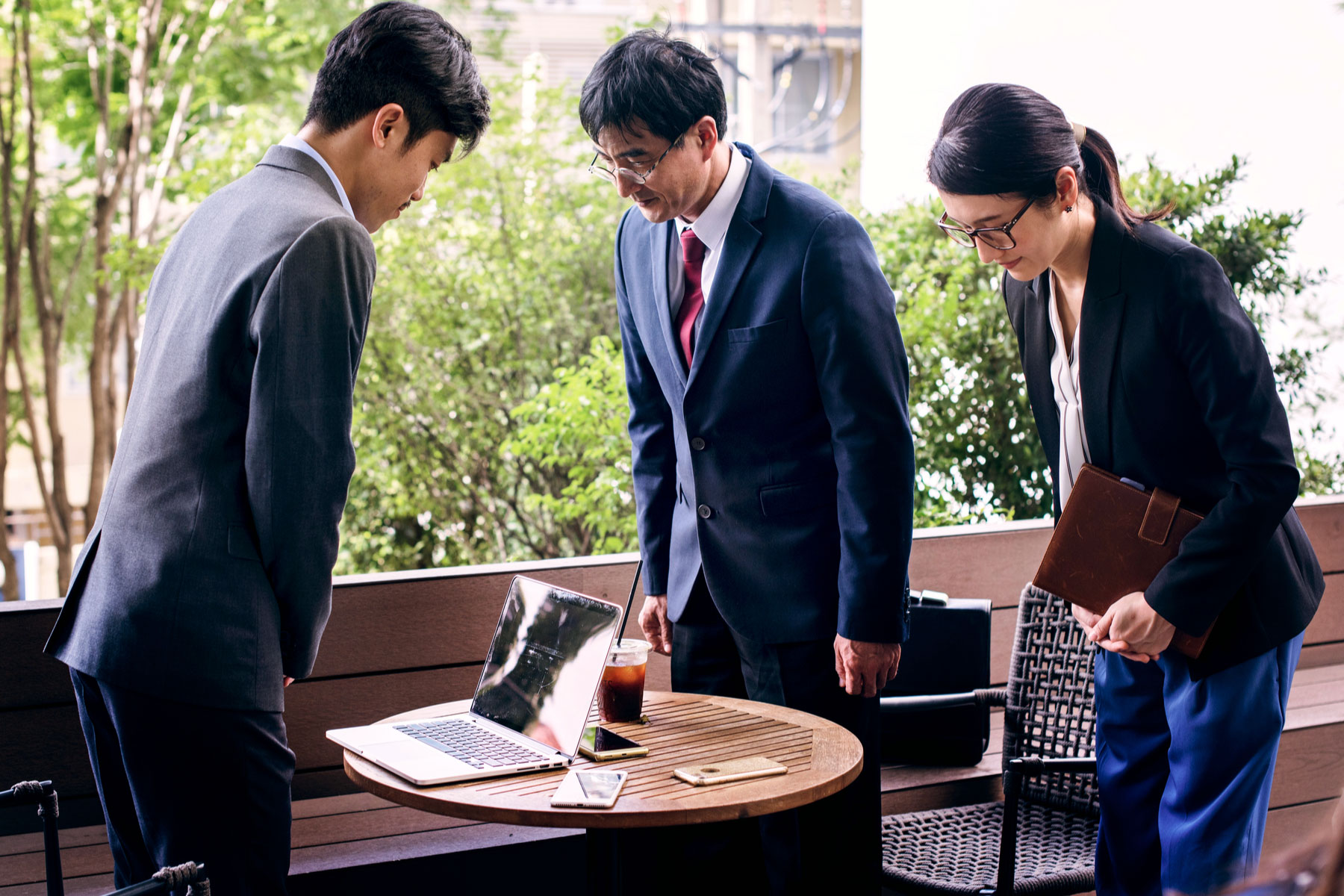 Businesspeople in Japan bowing before a meeting