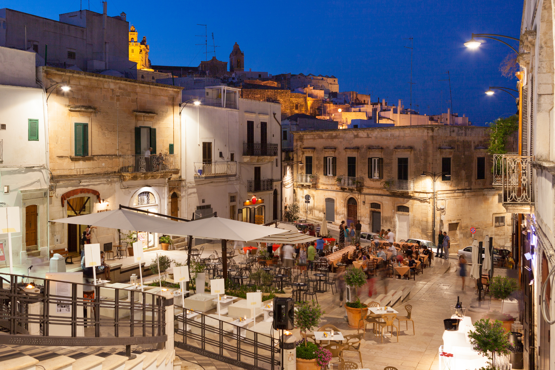 Old town with restaurants in Ostuni, Italy