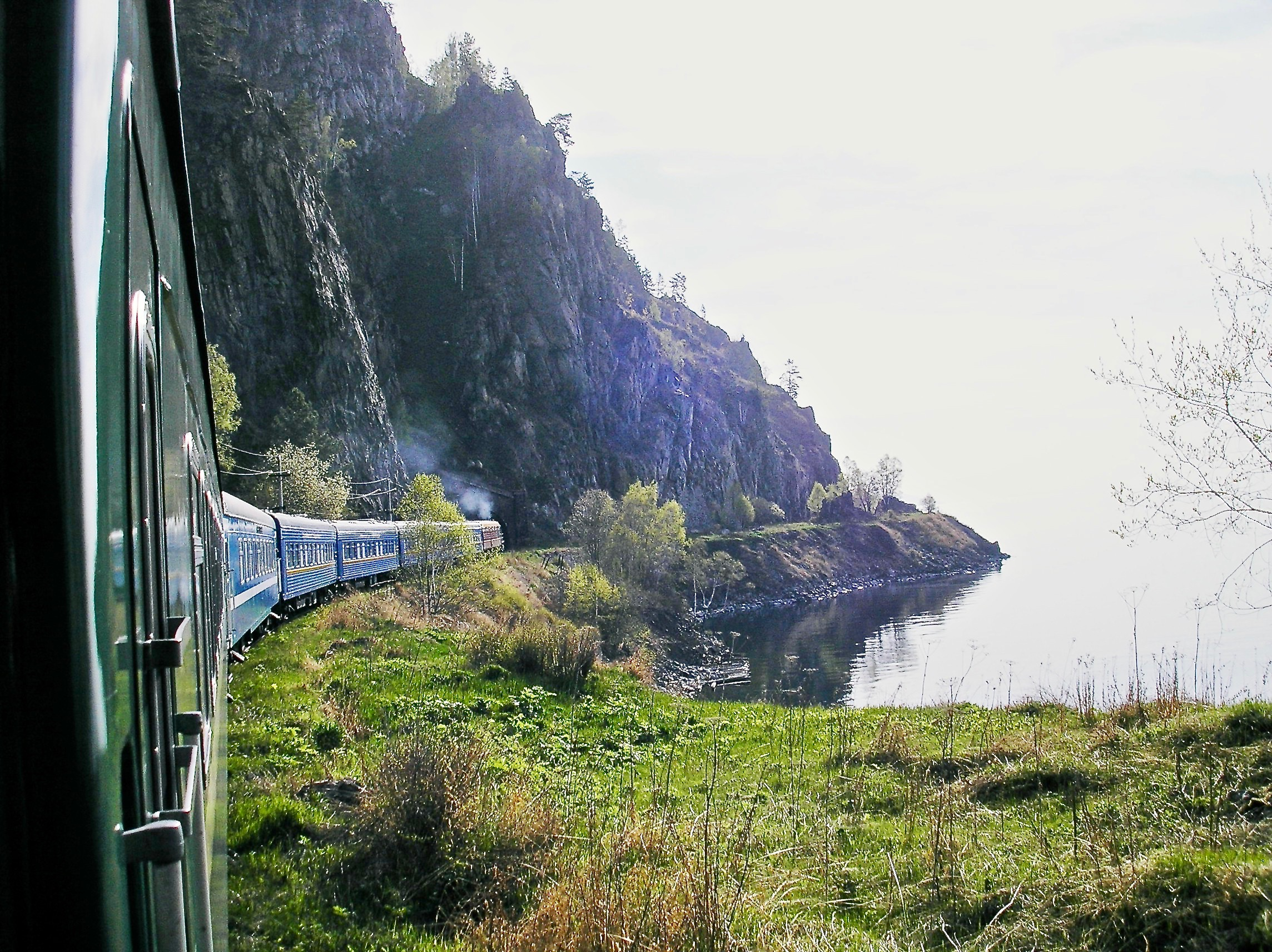 The famous Trans-Siberian Express passenger train, is seen in this picture skirting the rugged shores of Lake Baikal during midsummer, towards its final destination of Vladivostok.