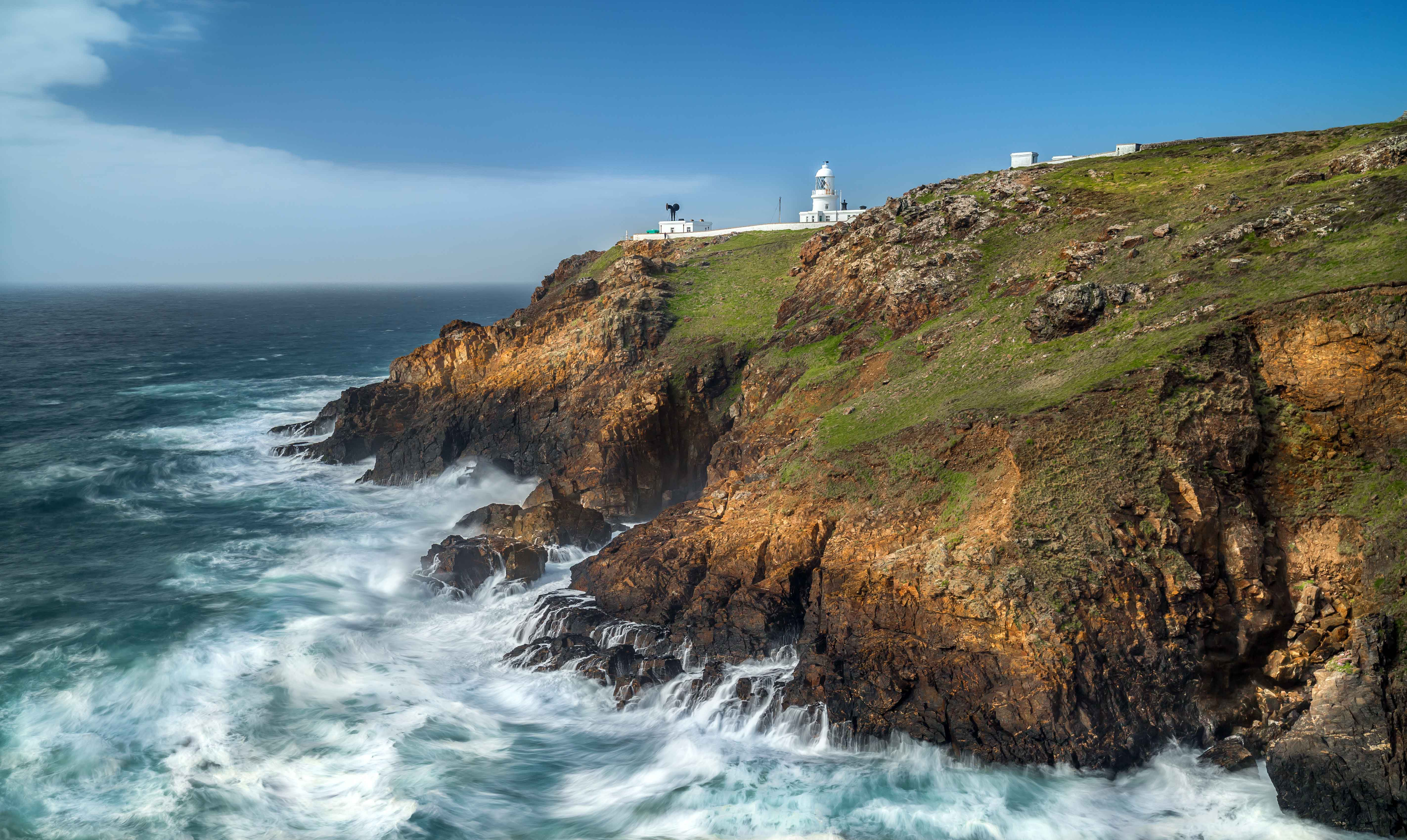 Canva---Dramatic-cliffs-and-wavess,-Pendeen-Point-lighthouse,-Cornwall