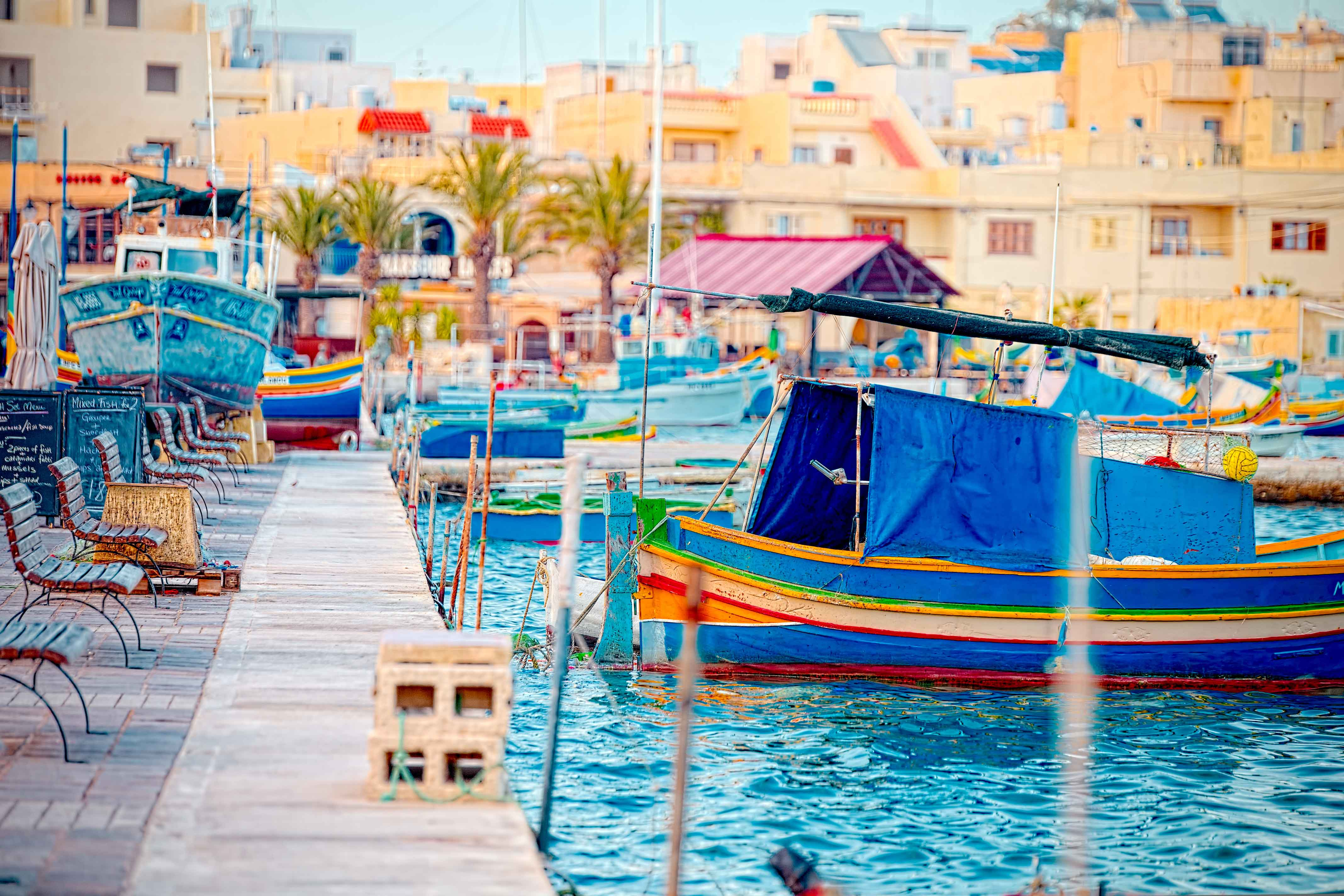 Canva---Luzzu-anchored-in-Malta,-at-the-port-of-Marsaxlokk