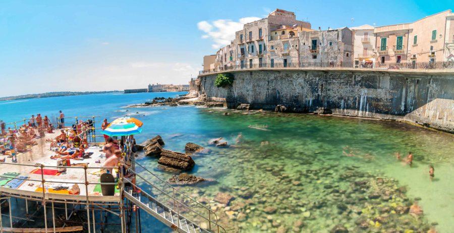 Canva---Ortigia-and-Mediterranean-Sea-in-Syracuse