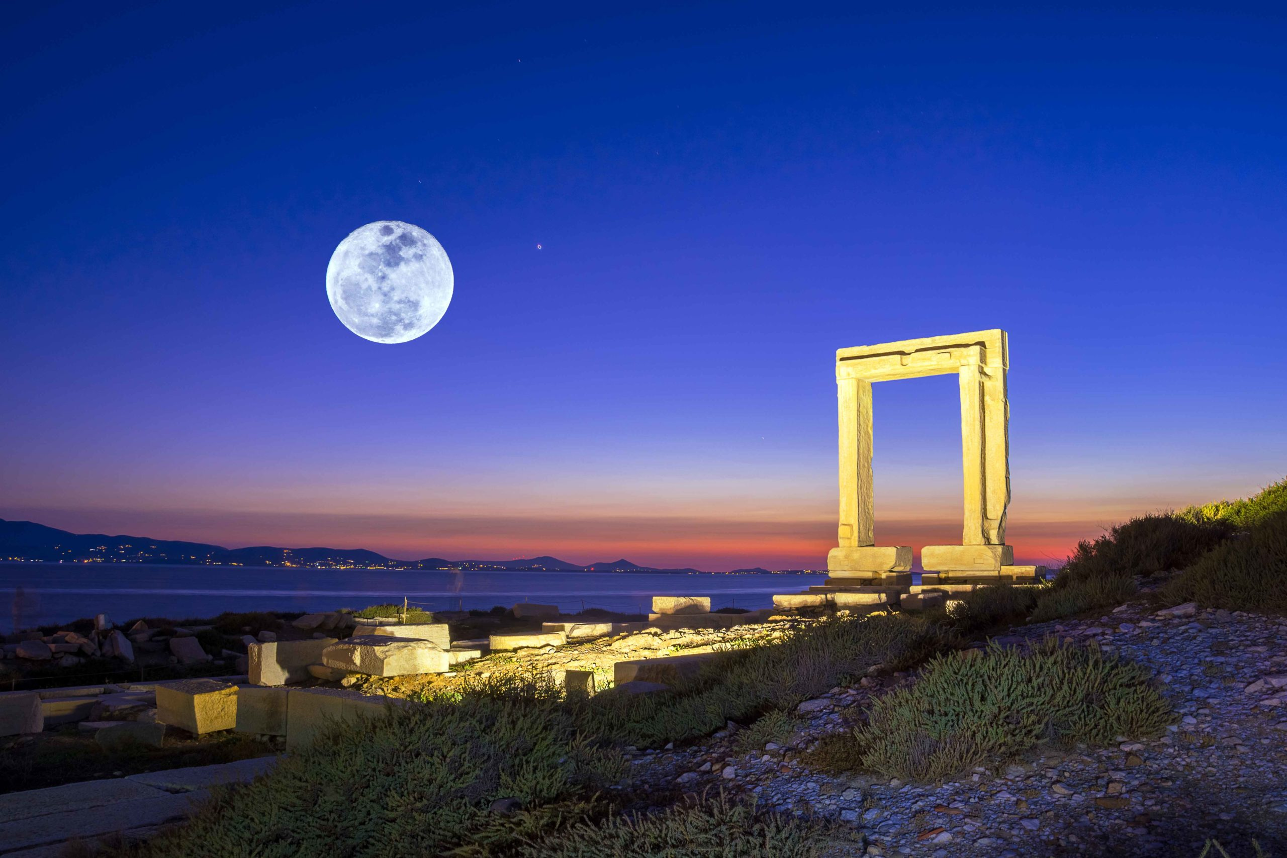 Canva---Portara---ruins-of-ancient-temple-of-Delian-Apollo-on-Naxos-island,-Cyclades,-Greece