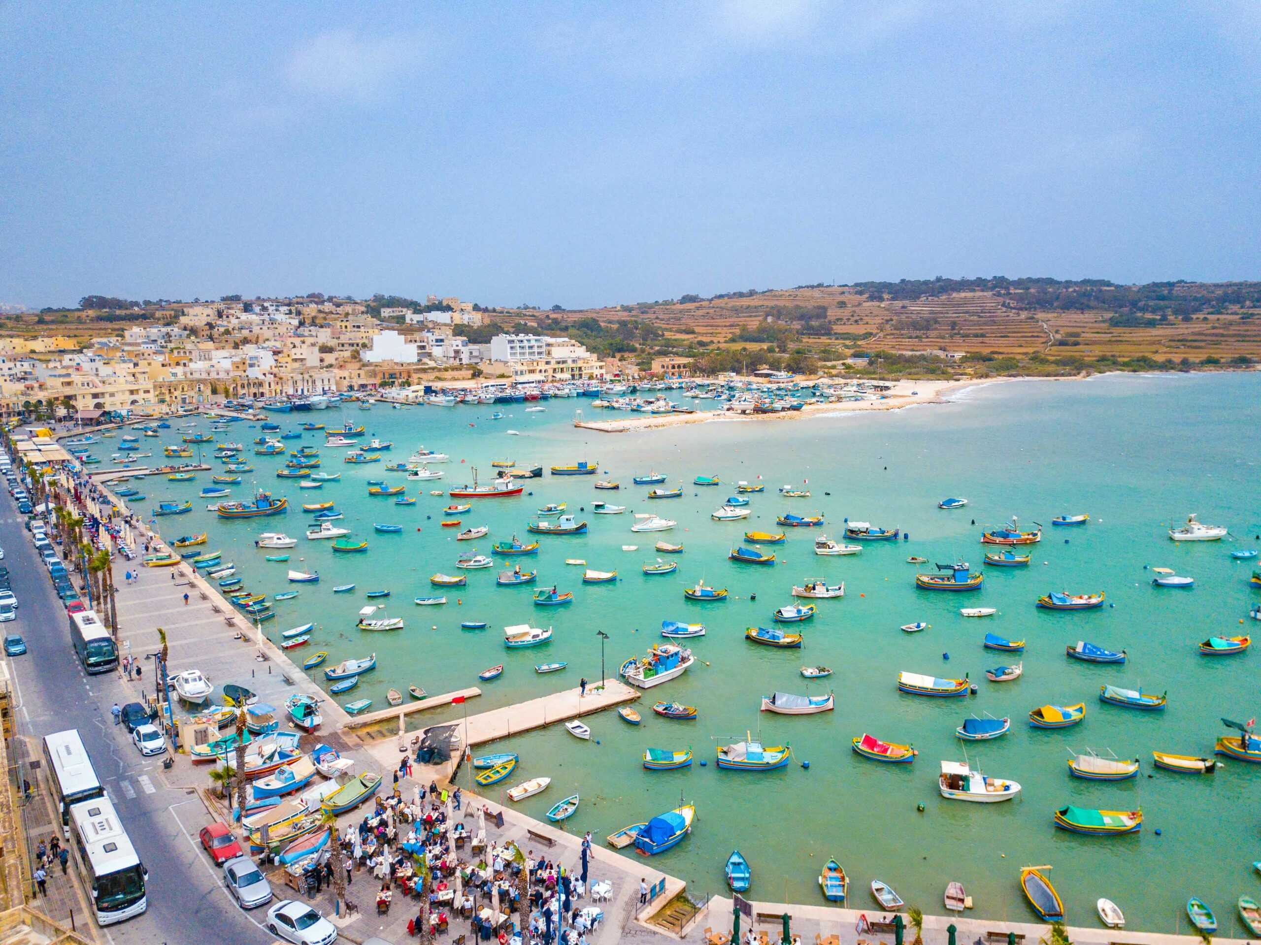 Canva---Traditional-eyed-colorful-boats-Luzzu-in-the-Harbor-of-Mediterranean-fishing-village