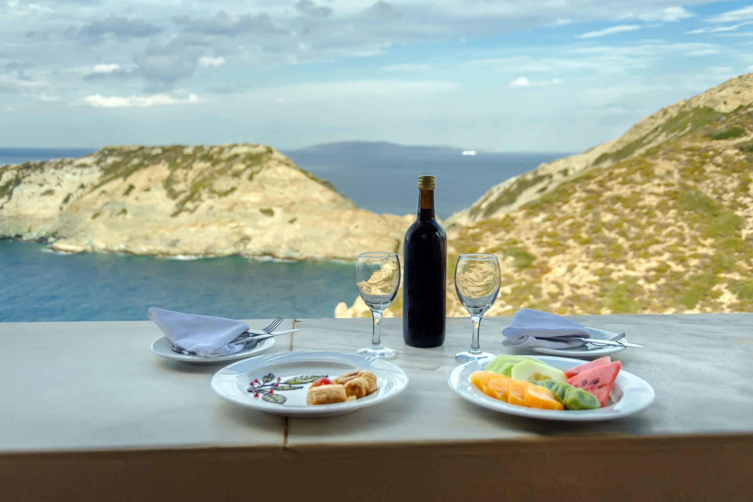 Canva---Wine-and-food-against-the-backdrop-of-the-sea-(1)