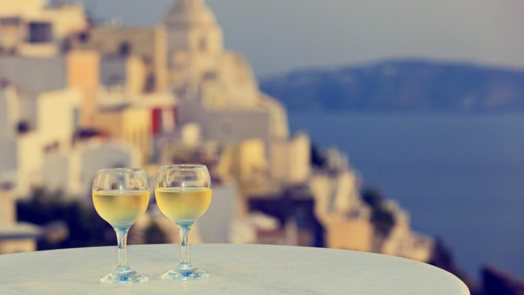 Enjoy a glass of local wine from one of Santorini's romantic terraces