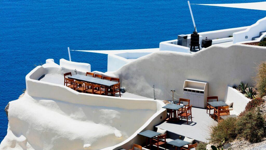 A restaurant overlooking the azure sea on Santorini, Greece