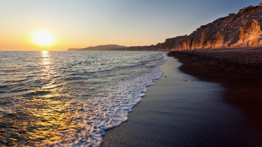 Sunset over one of Santorini's magnificent beaches