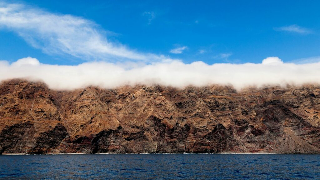 Misty clouds over the Desertas Islands, about 15km south of Madeira, Portugal